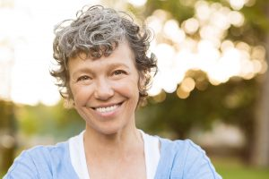Smiling senior woman with dental implants